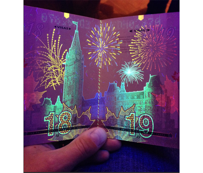 Article Image - Canadian passport viewed under blacklight