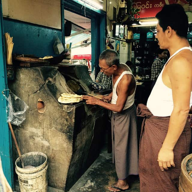 Teahouses are aplenty in Yangon. This man was making Chapati